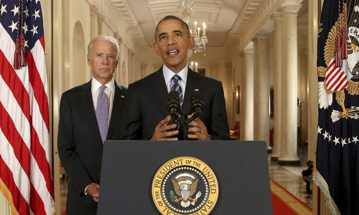 President Barack Obama, standing with Vice President Joe Biden, conducts a press conference  in the East Room of the White House in response to the Iran Nuclear Deal, on July 14, 2015 in Washington, DC. (Andrew Harnik - Pool/Getty Images)