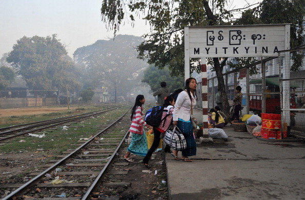 Myanmar women walk on a platform at the train station in Myitkyina, northern Kachin state on February 27, 2012. (Soe Than Win/AFP/Getty Images)