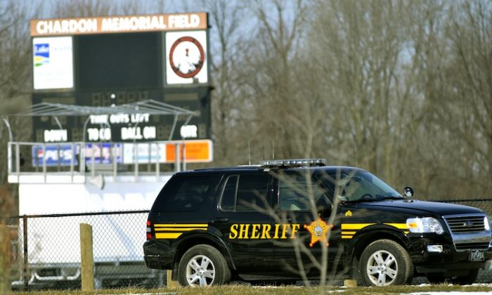 A Sheriff deputy's vehicle is parked in front of Chardon High School where a shooting took place on February 27, 2012 in Chardon, Ohio. T.J. Lane opened fire inside the high school cafeteria. (David Dermer/Getty Images)