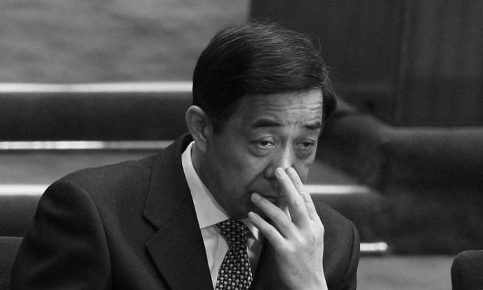 Bo Xilai attends the National People's Congress (NPC) on March 5 in Beijing, China. The former Chongqing party chief was recently exposed over his illicit dealings with overseas businesses. (Feng Li/Getty Images)