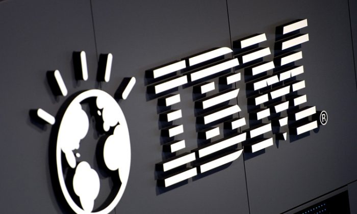 The IBM logo is seen at their booth prior to the start of the CeBIT 2012 technology fair on March 5 in Hanover, Germany. (Odd Andersen/AFP/Getty Images)