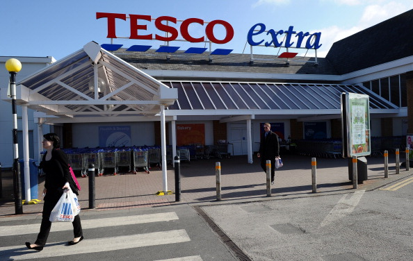 People leave a Tesco Extra supermarket in Birkenhead, north-west England, on March 5, 2012.  (Ellis/AFP/Getty Images)