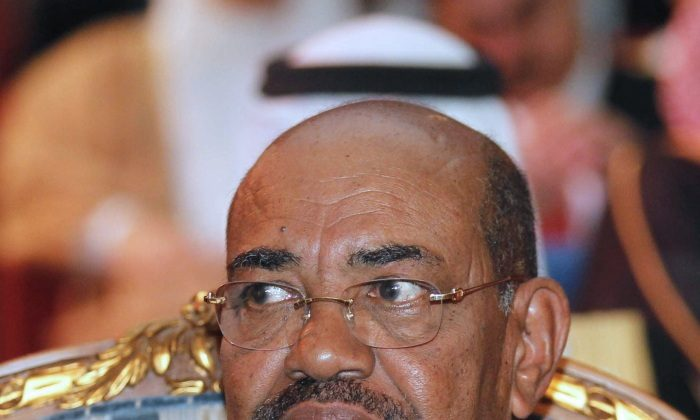Sudan's President Omar al-Bashir attends the opening of the Connect Arab Summit in Doha on March 6, 2012. (STR/AFP/Getty Images)