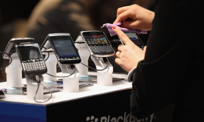 Visitors try out Blackberry smartphones at the Blackberry stand on the first day of the CeBIT 2012 technology trade fair on March 6, 2012 in Hanover, Germany. (Sean Gallup/Getty Images)