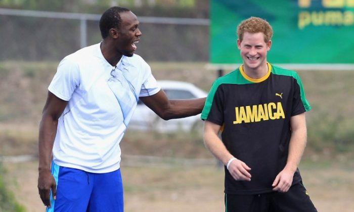 Prince Harry races Usain Bolt at the Usain Bolt Track at the University of the West Indies on March 6, 2012 in Kingston, Jamaica. (Chris Jackson/Getty Images)