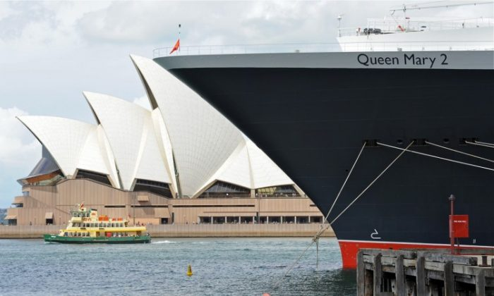 The Cunard super liner 'Queen Mary 2' berths opposite the Sydney Opera House on March 7, 2012. (Torsten Blackwood/AFP/Getty Images)