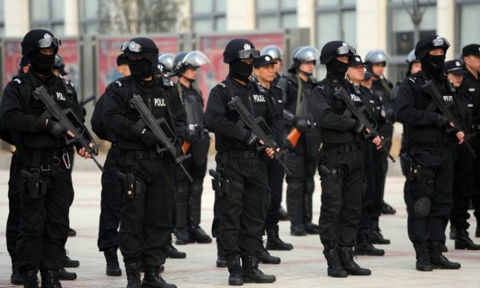 A squad of Chinese special police gather during a demonstration of their skills in Hefei, east China's Anhui province on March 11. China will spend US$111.6 billion on its police forces in 2012, the regime said as it focuses on quelling rising social unrest ahead of a 10-yearly leadership change. (STR/AFP/Getty Images)