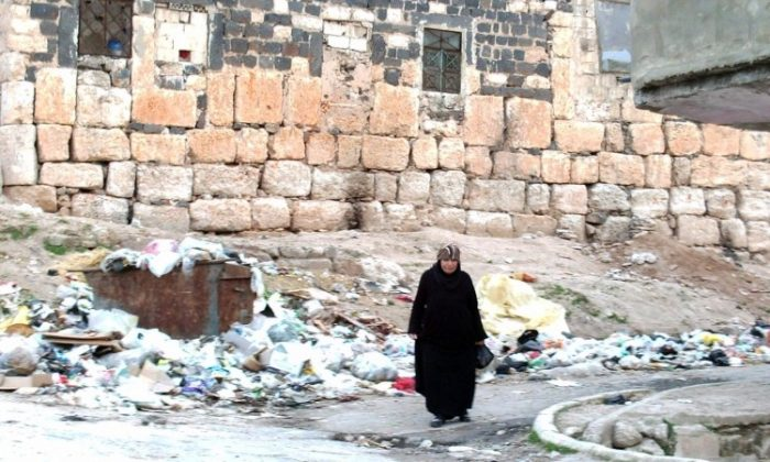 A Syrian woman walks along a street in the town of Rastan, located near Homs, on March 11, 2012. (AFP/Getty Images)