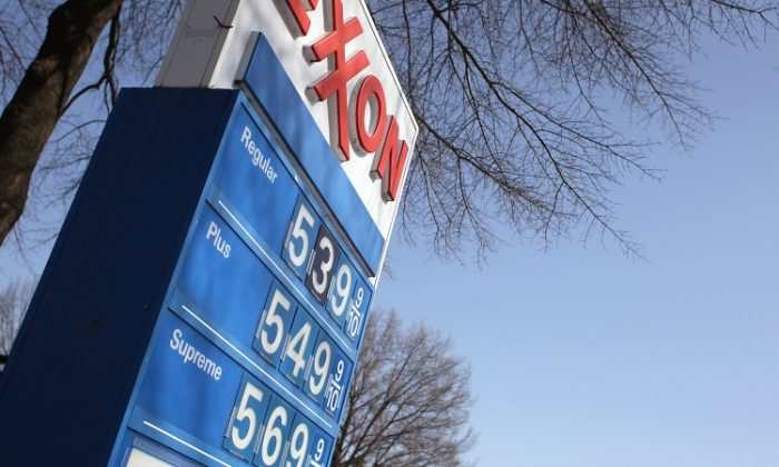 Gas prices have climbed past $5 a gallon in some U.S. cities. Critics blame Obama Administration energy policies for the rising price at the pump, but the President says many of the factors contributing to fuel costs are outside the government's control. (Mark Wilson/Getty Images)