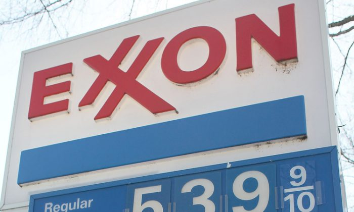 A sign shows gas prices over $5.00 a gallon for all three grades at an Exxon service station on March 13 in Washington, D.C. So far in 2012, U.S. car and light trucks sales improved over sales during the same period in 2011, but large car sales decreased by 87.3 percent and large SUVs by 7.8 percent. (Mark Wilson/Getty Images)