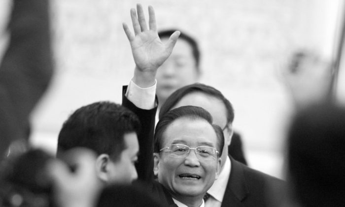 Chinese Premier Wen Jiabao waves to media as leaves after a press conference of the National People's Congress's (NPC) annual session on March 14, 2012. (Liu Jin/AFP/Getty Images)