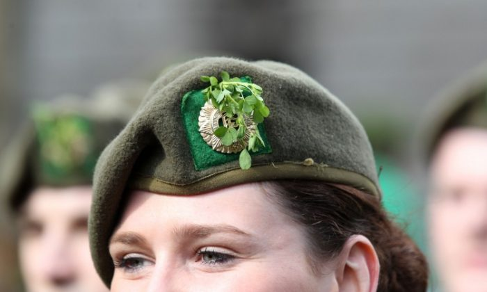 Picture of an Irish female army officer wearing a shamrock in her cap as she marches in the St Patrick's Day festivities in Dublin, Ireland on March 17, 2012. (PETER MUHLY/AFP/Getty Images)