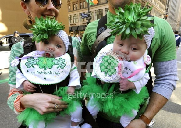 Young parade-goers Harley and Presley Eidens look on during the 251st St Patrick's Day Parade up Fifth Avenue on Saturday. (Timothy A. Clary/AFP/Getty Images)