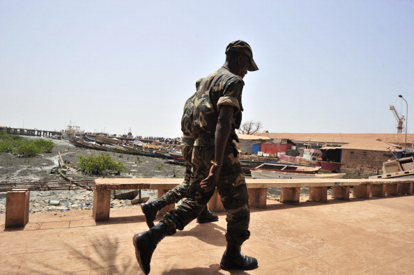 Soldiers walk on a bridge in Bissau, the capital of Guinea-Bissau, on March 19, 2012. (Issouf Sanogo/AFP/Getty Images)