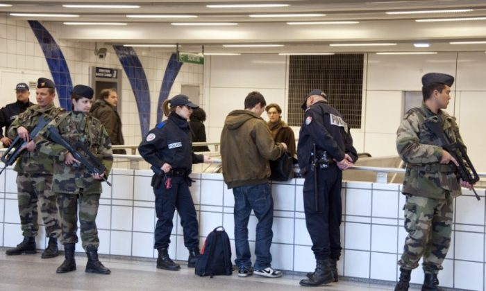 Soldiers and policemen check a passenger in the subway, one day after the shooting of the 'Ozar Hatorah' Jewish school, on March 20, 2012 in Toulouse, southwestern France. (Pascal Pavani/AFP/Getty Images)