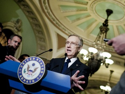 """Senate Majority Leader Harry Reid (D-Nev.) speaks to the media at Capitol on March 20 in Washington. Speaking recently on the Postal Reform Bill's introduction to the Senate he said he did not believe the legislation was """"a perfect compromise"""", however, he said, """"it is a good compromise, and a bipartisan one."""" (T.J. Kirkpatrick/Getty Images)"""