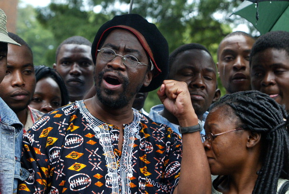 Human rights activist and former lawmaker Munyaradzi Gwisai speaks to the press at the Magistrate's court in Harare on March 21 2012. (Jekesai Njikizana/AFP/Getty Images)
