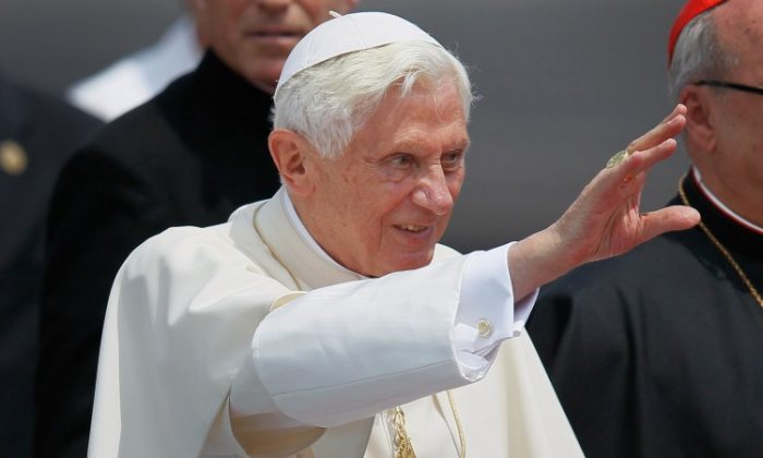 Pope Benedict XVI (2nd R) waves as he walks to his car during a welcoming ceremony after arriving at the Jose Marti International airport on the second day of his three-day visit on March 27, 2012 in Havana (Joe Raedle/Getty Images)