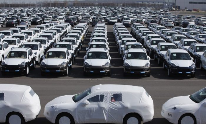 Freshly assembled Porsche Cayenne SUVs line a parking lot before shipping at the Porsche factory in Leipzig, Germany, on March 28. (Sean Gallup/Getty Images)