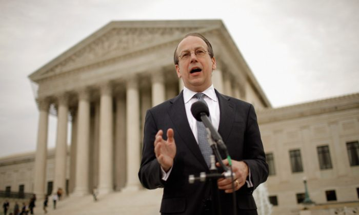 Paul Clement, the attorney representing the 26 states challenging the Patient Protection and Affordable Care Act, talks to the news media outside the U.S. Supreme Court on the third day of oral arguments over the constitutionality of the act. (Somodevilla/Getty Images)