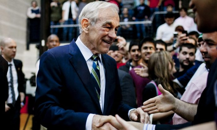 Republican Presidential hopeful Rep. Ron Paul (R-Texas) greets supporters during a town hall meeting at the University of Maryland on March 28 in College Park, Md. Paul has said he will continue his campaign as Republican presidential nominee, the last remaining rival to Romney, despite failing to win any states so far. (T.J. Kirkpatrick/Getty Images)