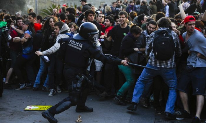 Riot police clash with demonstrators during heavy clashes with demonstrators during a 24-hour strike on March 29, 2012 in Barcelona, Spain. (David Ramos/Getty Images)