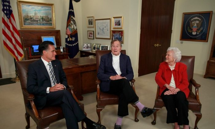 Republican presidential candidate, former Massachusetts Gov. Mitt Romney (L) meets with Former President George H.W. Bush and Barbara Bush at Bush's office on March 29, in Houston, Texas. Mitt Romney received an endorsement from Former President George H.W. Bush and Barbara Bush during the meeting. (Tom Pennington/Getty Images)