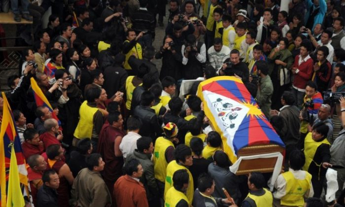 The coffin of Jamphel Yeshi, who died after self-immolation on March 28 in New Delhi, is carried for cremation after a ceremony at Tsuglakhang Temple in McLeod Ganj on March 30, 2012. More than 30 Tibetans have set themselves on fire since March 2011. (Lobsang Wangyal/AFP/Getty Images)