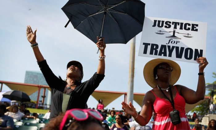 Trayvon Martin supporters gather for a rally in his honor at the Bayfront Amphitheater on April 1, in Miami, Florida. Martin was killed by George Michael Zimmerman who was on neighborhood watch patrol in the gated community of The Retreat at Twin Lakes, Florida. (Joe Raedle/Getty Images)