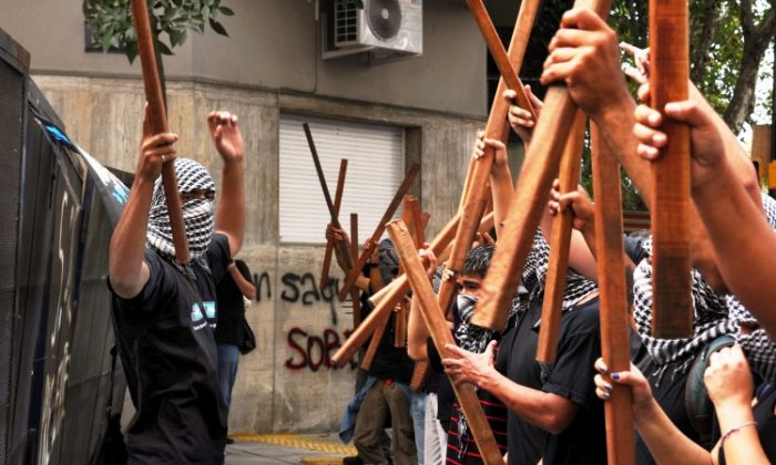 Members of Quebracho political group demonstrate in front of the fences that block their way to the British embassy in Buenos Aires on April 2, 2012. (Daniel Garcia/AFP/Getty Images)