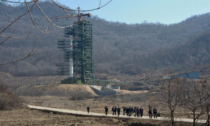 North Korean officials and foreign journalists leave the launch pad after a visit to see the rocket in Tangachai -ri space center on April 8, 2012. North Korea has confirmed their intentions to launch the rocket next week despite international condemnations. (Pedro Ugarte/AFP/Getty Images)