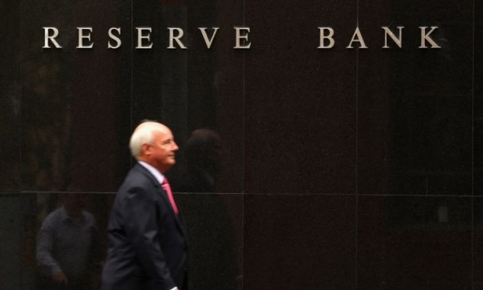 A man walks past the Reserve bank in Sydney, Australia. (Cameron Spencer/Getty Images)