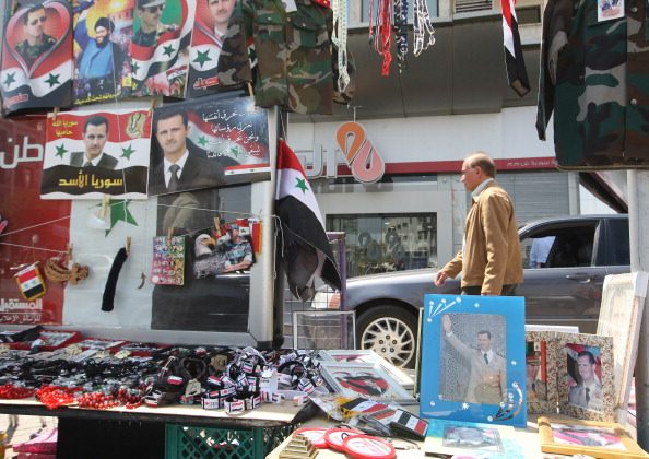 Memorabilia picturing Syrian President Bashar Al-Assad is displayed for sale in Damascus on April 12, 2012, as a UN-backed ceasefire went into effect.(Louai Beshara/AFP/Getty Images)