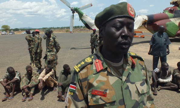 Sudanese war prisoners from Sudan Armed Forces (seated on the ground), captured in several days of bloody fighting, arrive in the South Sudanese capital of Juba on April 15, 2012. (Waakhe Wudu/AFP/Getty Images)
