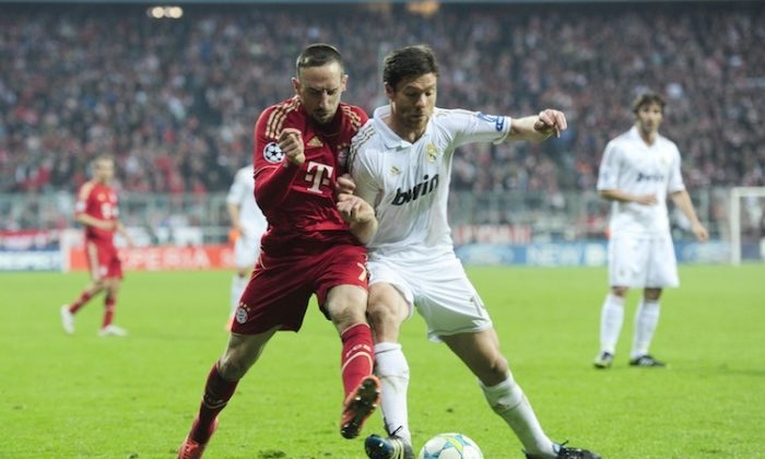 Franck Ribery and Xabi Alonso tangle in a tantalizing Champions League semifinal between Bayern Munich and Real Madrid on Tuesday in Munich. (Javier Soriano/AFP/Getty Images)