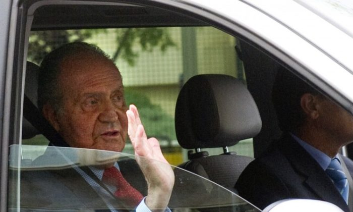 Spanish King Juan Carlos leaves the San Jose hospital in Madrid on April 18. He was hospitalised after breaking his hip on an African elephant hunting trip, which provoked a scandal in Spain. (Pierre-Philippe Marcou /AFP/Getty Images)