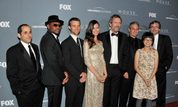 (L-R) Actors Peter Jacobson, Omar Epps, Jesse Spencer, Odette Annable, Hugh Laurie, creator David Shore, actress Charlyne Yi and actor Robert Sean Leonard arrive at Fox's 'House' series finale wrap party at Cicada on April 20, 2012 in Los Angeles, California. (Kevin Winter/Getty Images)