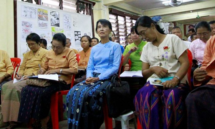 Burmese opposition leader Aung San Suu Kyi (C) attends a meeting of her National League for Democracy at the party's headquarters in Yangon on April 22. (Ye Aung Thu/AFP/Getty Images)