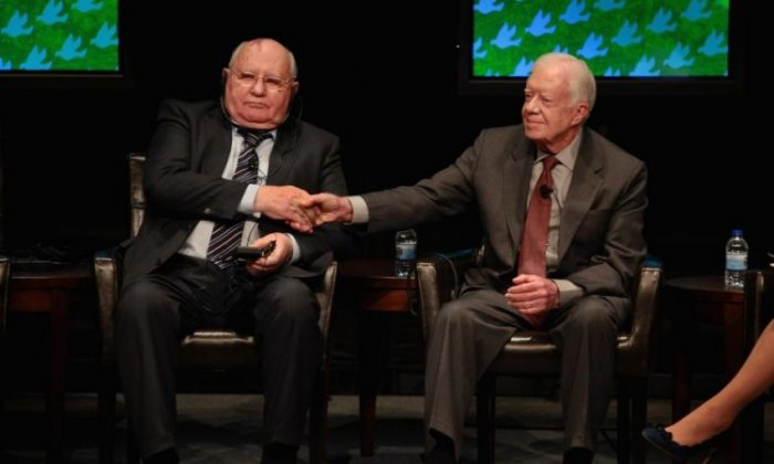 Former Russian President Mikhail Gorbachev (L) greets former U.S. President Jimmy Carter prior to a panel discussion at the University of Illinois at Chicago as part of the World Summit of Nobel Peace Laureates on April 23 in Chicago, Ill. The 12th World Summit of Nobel Peace Laureates convenes in Chicago today and runs through Wednesday, April 25. (Scott Olson/Getty Images)