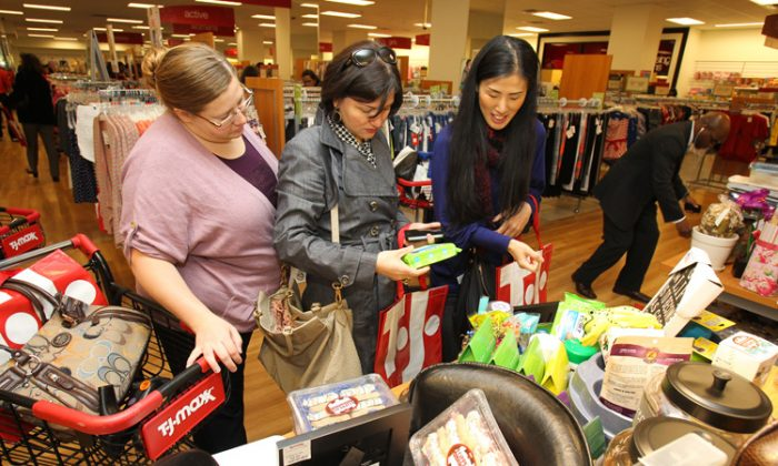 Customers shop at the opening of T.J. Maxx's 1,000th store on April 25 in Washington. On Thursday, TJX, which runs T.J. Maxx, reported an 8 percent increase in same-store sales. (Paul Morigi/Getty Images for TJ Maxx)