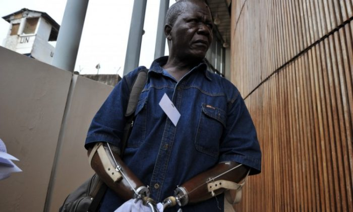 Sierra Leonian amputee association chairman Alhaji Jusu Jarka walks outside the Special Court in Freetown on April 26, 2012. (Issouf Sanogo/AFP/GettyImages)