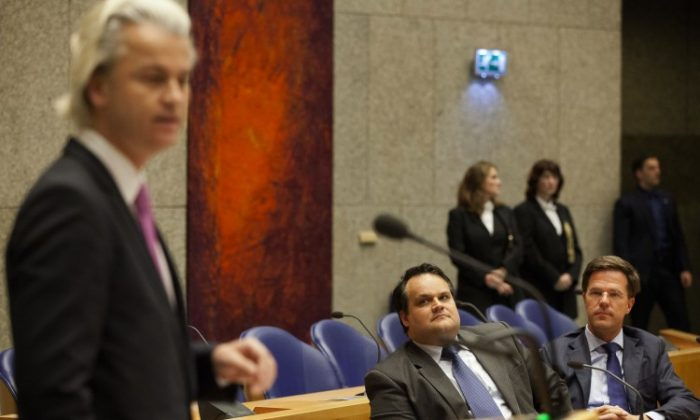 Dutch Finance minister Jan Kees de Jager (C) and Prime Minister Mark Rutte (R) look at PVV-party leader Geert Wilders as they attend a debate in the parliament in The Hague about the agreement about budget cuts on April 26, 2012. (Phil Nijhuis/AFP/GettyImages)