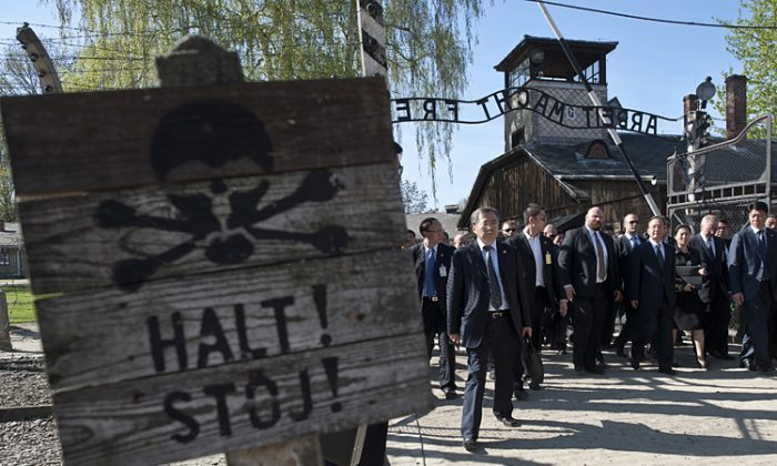 Chinese Premier Wen Jiabao (Third from right) visits the site of the the former Nazi German Auschwitz-Birkenau death camp. When Premier Wen Jiabao chose to give remarks at the site of the Auschwitz concentration camp, he was speaking to the Chinese people, argue the authors of this article. (Pawel Ulatowski/AFP/GettyImages)