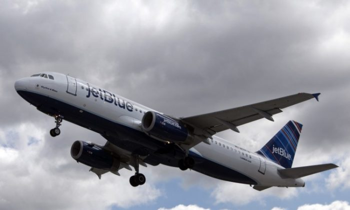 A JetBlue plane at John F. Kennedy International Airport. JetBlue was fined $90,000 for not telling passengers on a delayed flight that they could leave the plane. (Allison Joyce/Getty Images)