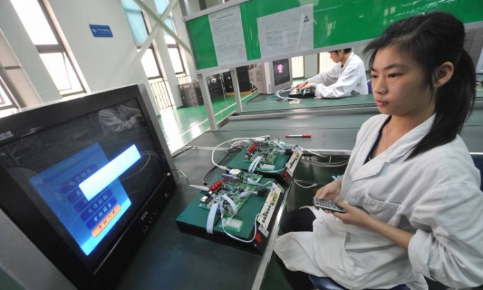 Chinese workers test the circuit boards at a factory in Mianyang, southwest China's Sichuan province on April 30, 2012 (STR/AFP/Getty Images)
