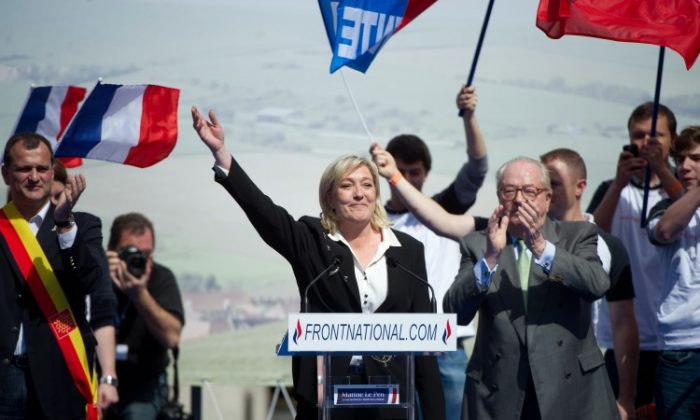 French far right party Front National (FN) former presidential candidate Marine Le Pen (C) waves as she arrives to give a speech during the FN's annual celebration on May 1, 2012. (Bertrand Langlois/AFP/GettyImages)