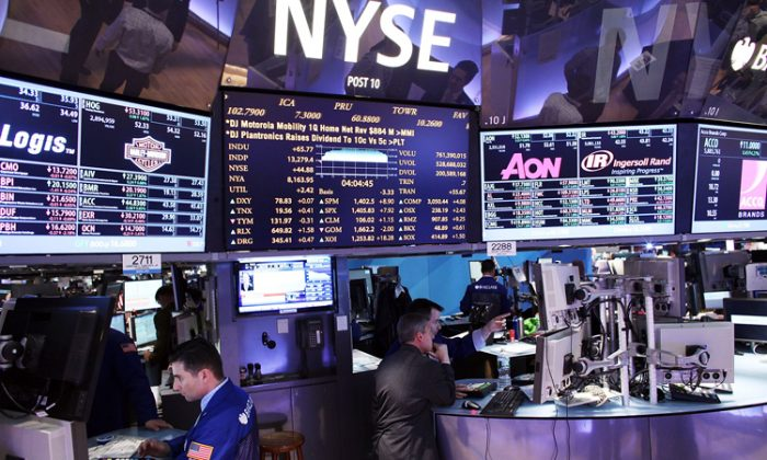 Traders work on the floor of the New York Stock Exchange on May 1 in New York City. On Wednesday, following a weak trading session in Europe, the Dow Jones Industrial Average fell 0.08 percent, or 11 points, to 13,269 points. (Spencer Platt/Getty Images)