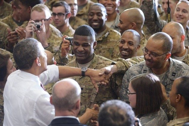 President Barack Obama greets troops during a visit to Bagram Airfield yesterday in Afghanistan. Obama signed a U.S.-Afghanistan strategic partnership agreement during his unannounced visit to the country. (Mandel Negan/AFP/GettyImages)