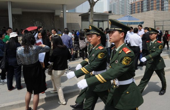 Chinese military policemen march to change guard outside the U.S. Embassy in Beijing on May 2. (Mark Ralston/AFP/Getty Images)