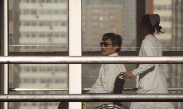 Chinese activist activist Chen Guangcheng is pushed in a wheelchair by a nurse at the Chaoyang hospital in Beijing on May 2, 2012. He agreed to leave U.S. care after receiving promises of safety by the Chinese regime. (Jordan Pouille/AFP/GettyImages)